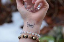 Beautiful butterfly on the wrist