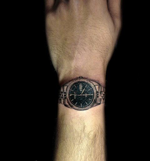 Black and emerald watch tattoo