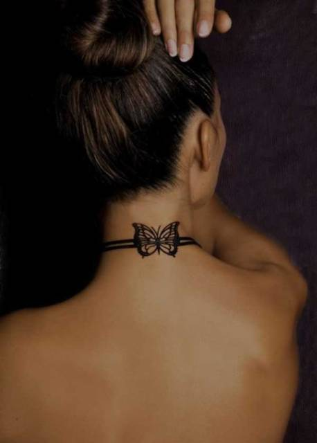Black-contour butterfly on the neck