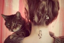 Black-contour cat tattoo