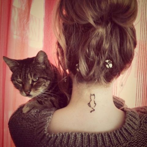 Black contour cat tattoo