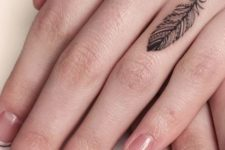 Black feather tattoo