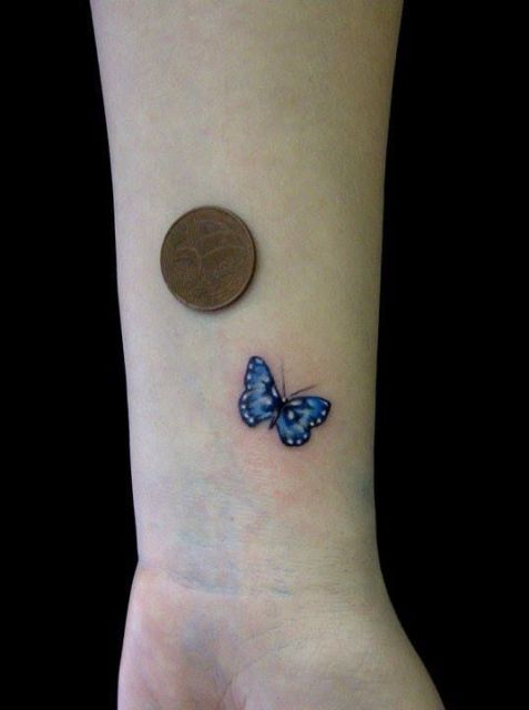 Blue small butterfly tattoo