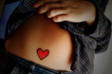Bright red heart on the stomach