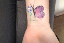 Butterfly with flower tattoo on the wrist