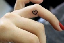 small finger heart tattoo