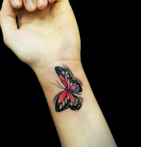 Colored 3D butterfly on the left wrist