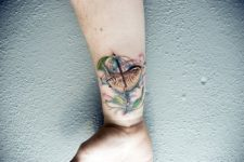 Colored bird tattoo idea