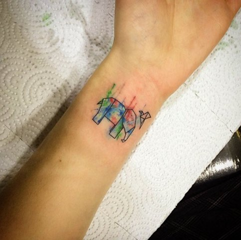 Colored paper elephant with flying bird tattoo