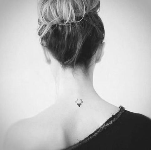 Deer tattoo on the neck