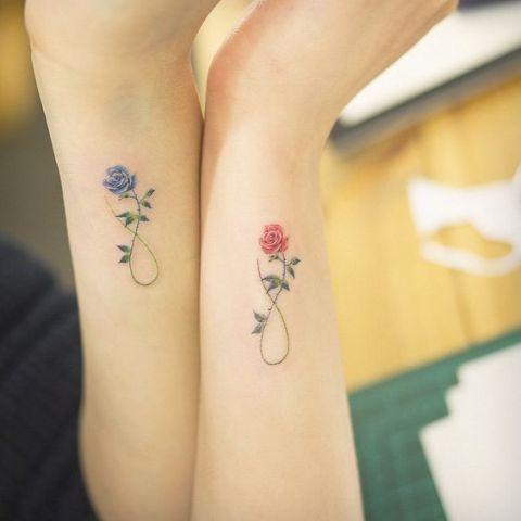 Elegant tiny flower tattoo