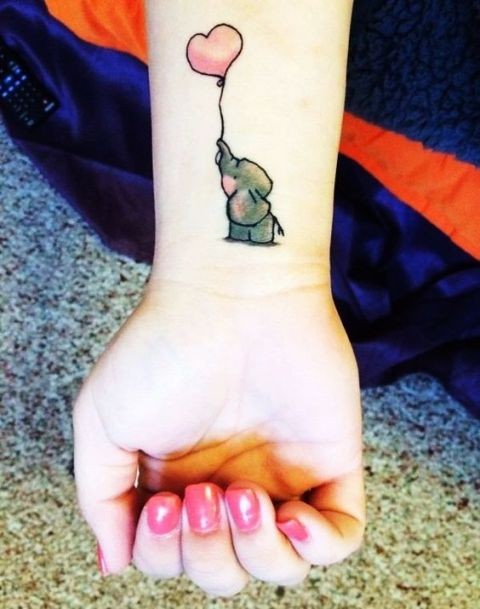Gray elephant with heart balloon tattoo