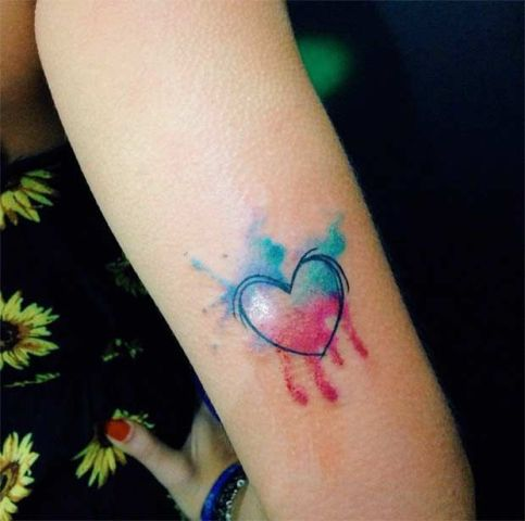 Light blue and pink tattoo on the arm