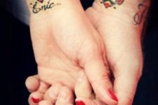Matching red and black tattoos