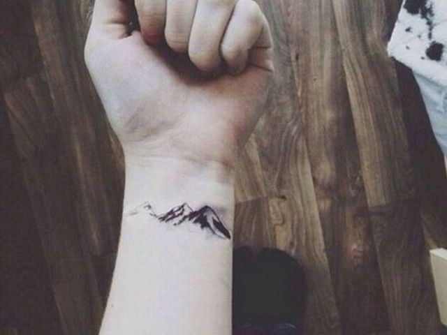 Mountain designed tattoo