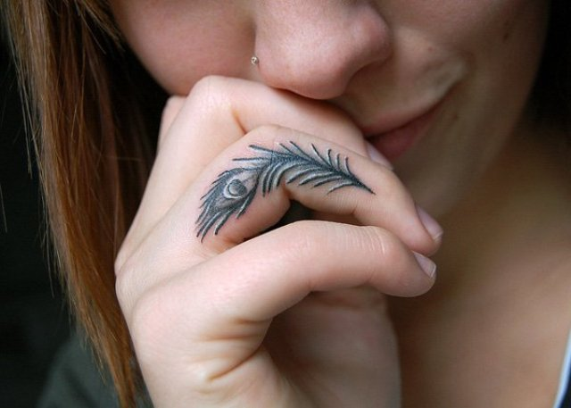 Peacock feather finger tattoo idea