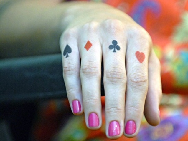 Poker card symbols tattoo