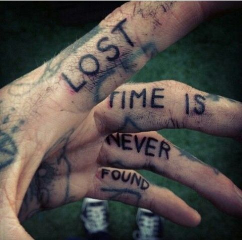 Quote tattoo on each finger