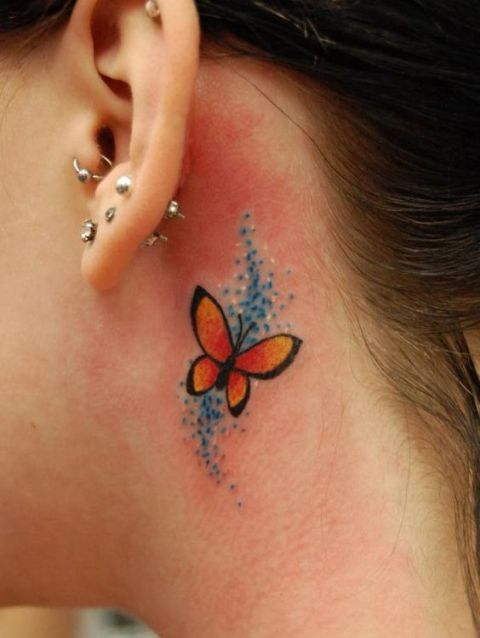 Red and orange butterfly behind the ear