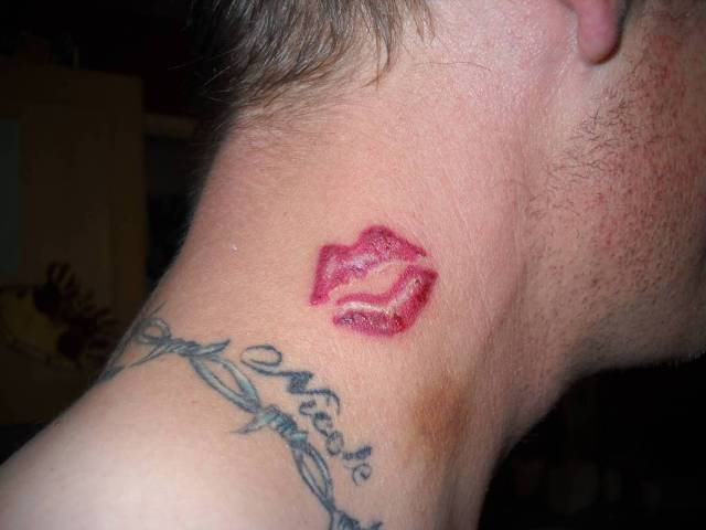 Red lips tattoo