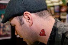 Red superman sign tattoo