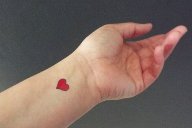 Red tattoo on the wrist