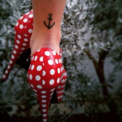 Simple anchor tattoo on the leg