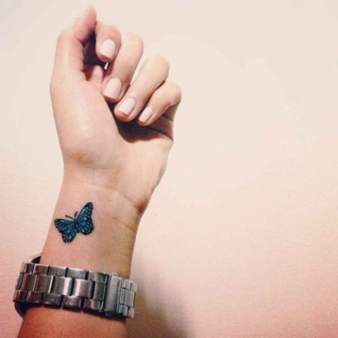 Simple blue tattoo on the wrist