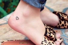 Simple heart tattoo on the foot