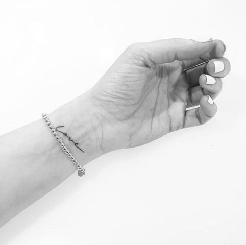Simple word love tattoo