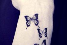 Three little butterflies on the wrist