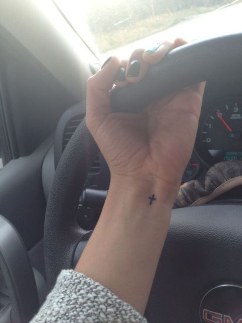 Tiny cross on the left wrist