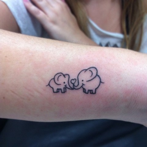 Two elephants tattoo on the arm