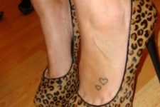 Two hearts tattoo on the left foot