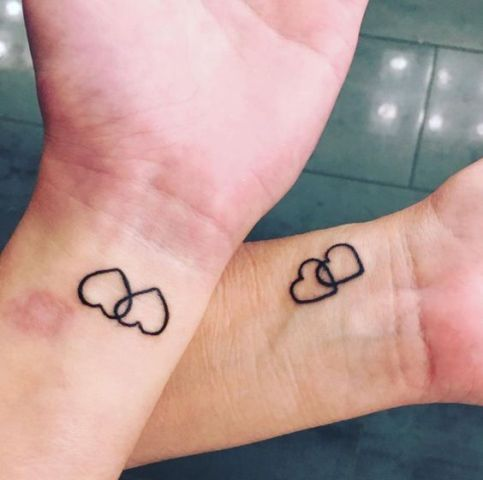 Two hearts tattoo on the wrist