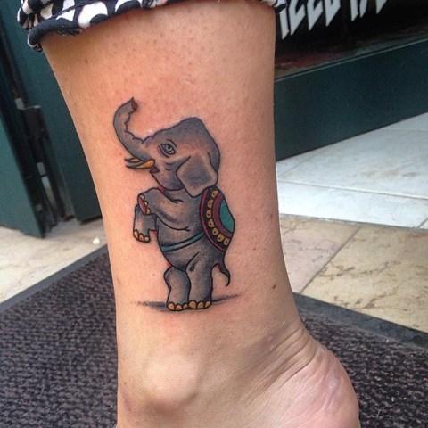 Unique elephant tattoo on the leg