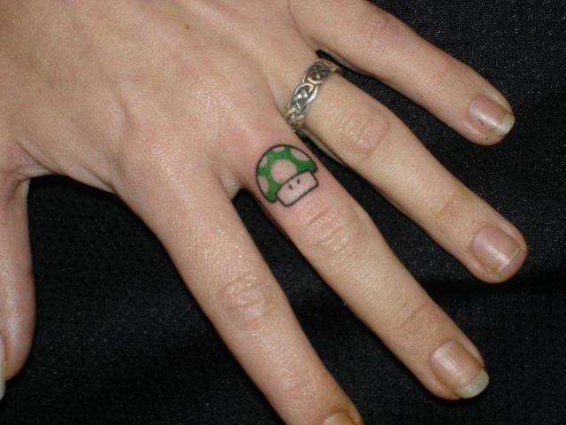 Tattoo Wedding Ring Ideas 84 Inspirational Video game mushroom tattoo