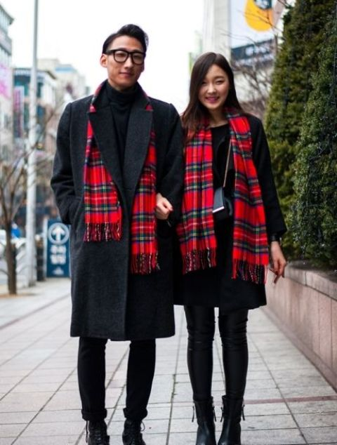 With black coat, pants, turtleneck and boots