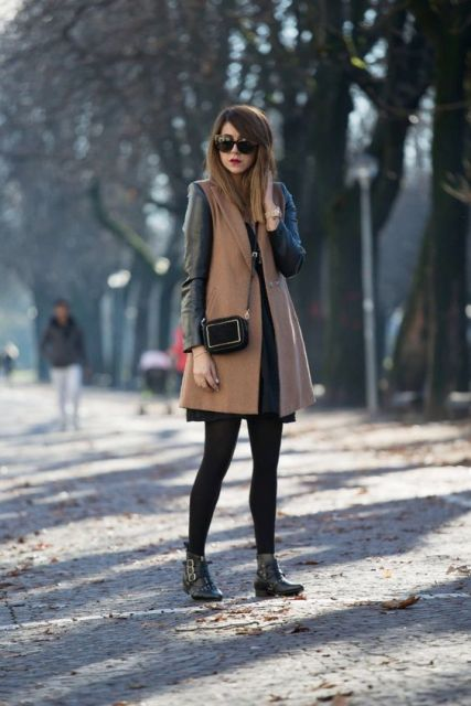 With black dress, black tights and crossbody bag