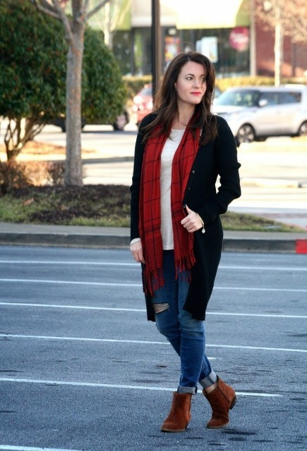 With black long blazer, white shirt, distressed jeans and suede boots