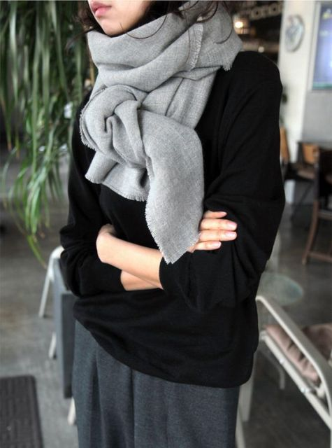 With black loose sweater and gray pants