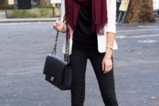 With black shirt and pants, high boots and white jacket