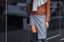 With brown leather jacket, gray skirt, over the knee suede boots and mini bag