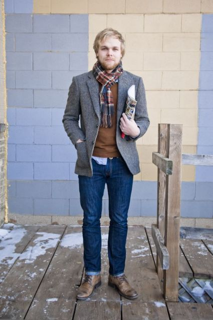 With brown shirt, tweed jacket, jeans and boots