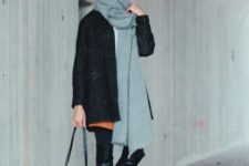 With brown skirt, mini coat, over the knee boots and chain strap bag