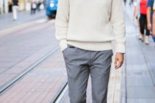 With button down shirt, gray pants and shoes
