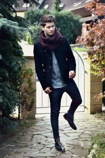 With button down shirt, skinny jeans, navy blue short coat and black boots