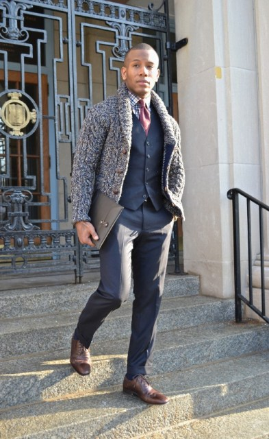 Stylish layering winter look with checked shirt, navy blue vest, gray trousers and brown shoes