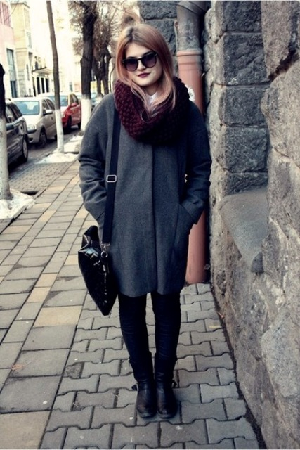 With dark gray coat, black bag, pants and boots