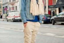 With denim jacket, beige pants and white sneakers
